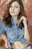 Cheerful young teen girl in denim shorts. Cheerful young teen girl in denim jeans shorts Stock Images