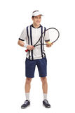 Cheerful young tennis player holding a racket. Full length portrait of a cheerful young tennis player holding a racket isolated on white background Royalty Free Stock Photography