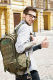 Cheerful young tourist is traveling across town Royalty Free Stock Photography