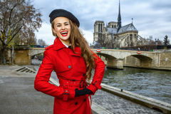 Cheerful young tourist woman on embankment in Paris, France Stock Image