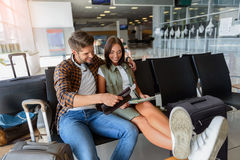 Cheerful young tourists sitting near luggage Royalty Free Stock Photography