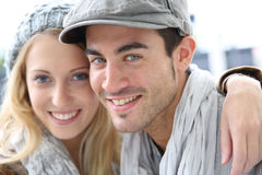 Cheerful young trendy couple wearing winter clothes stock photos