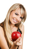 Cheerful young woman with an apple Royalty Free Stock Photography