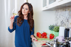 Cheerful young woman in apron on modern kitchen Royalty Free Stock Image