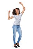 Cheerful young woman with arms raised Stock Photos