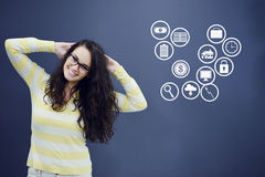 Cheerful young woman with background with drawn business chart, arrow and icons. Successful business concept Stock Photos
