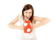 Cheerful young woman with ball Stock Photo