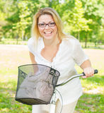 Cheerful Young Woman on the Bike Stock Image