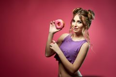 Young woman with donut. Royalty Free Stock Photography