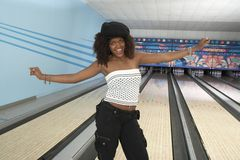 Cheerful Young Woman At Bowling Alley Royalty Free Stock Photography
