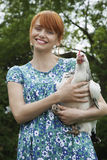 Cheerful Young Woman Carrying Hen Royalty Free Stock Photo