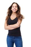 Cheerful young woman in casual clothes smiling with arms crossed Royalty Free Stock Images