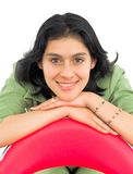 Cheerful young woman with chair Royalty Free Stock Images