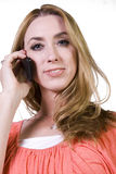 Cheerful young woman chatting on phone Stock Image