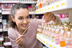 Cheerful young woman choosing fragrance Royalty Free Stock Photography