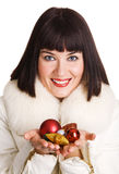 Cheerful young woman with Christmas toys Stock Images