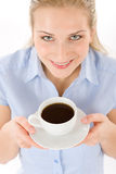 Cheerful young woman with coffee Royalty Free Stock Photo