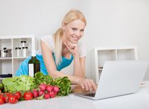 Cheerful young woman cooking Stock Photo