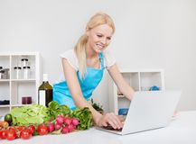 Cheerful young woman cooking Royalty Free Stock Photography