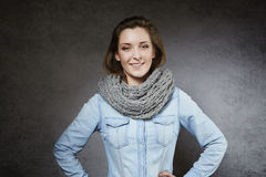 Cheerful young woman in cosy scarf Royalty Free Stock Photo