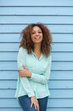 Cheerful young woman with curly hair laughing outdoors Royalty Free Stock Photography