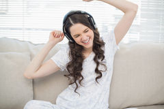 Cheerful young woman dancing while listening to music Royalty Free Stock Photography