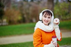 Cheerful young woman with donut Stock Photos