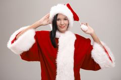 Cheerful young woman dressed as Santa Stock Photos