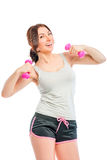 Cheerful young woman with dumbbells Royalty Free Stock Photos