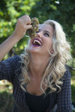 Cheerful young woman eating grapes in vineyard. Royalty Free Stock Photo