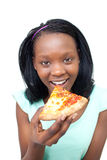 Cheerful young woman eating a pizza Royalty Free Stock Images
