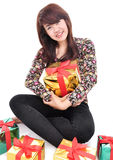 Cheerful young woman embracing many gifts Stock Photo