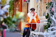 Cheerful young woman enjoying Christmas season in Paris Royalty Free Stock Images