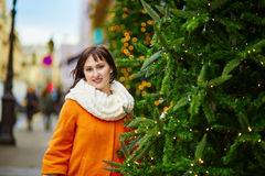 Cheerful young woman enjoying Christmas season in Paris Royalty Free Stock Photo