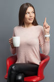 Cheerful young woman is enjoying hot tea royalty free stock images