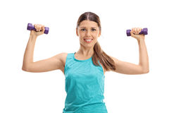 Cheerful young woman exercising with dumbbells Stock Images
