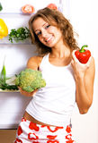Cheerful young woman with fresh vegetables royalty free stock photography