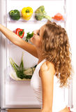 Cheerful young woman with fresh vegetables Royalty Free Stock Image