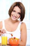 Cheerful young woman has vegetarian lunch Stock Photography