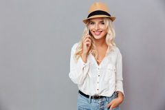 Cheerful young woman in hat talking on mobile phone Stock Photography