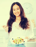 Cheerful young woman have lunch at home Royalty Free Stock Image