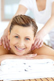 Cheerful young woman having a back massage Royalty Free Stock Photo