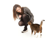 Cheerful young woman with her lovely cat Stock Images