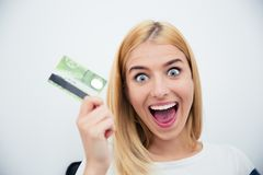 Cheerful young woman holding bank card Stock Images