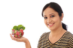 Cheerful young woman holding a bowl of strawberries Stock Photos