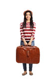 Cheerful young woman holding a briefcase Royalty Free Stock Images