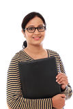 Cheerful young woman holding a folder Stock Image