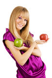Cheerful young woman holding fresh apples Stock Photos