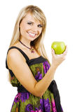 Cheerful young woman holding a fresh freen apple. White background Stock Photos