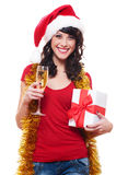 Cheerful young woman holding glass and gift Stock Photography